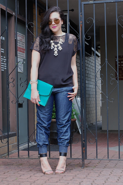 Denim jogging pants, Forever 21 silk shirt, Coach Legacy clutch, Ily Couture necklace and Preen X Aldo Rise heels.