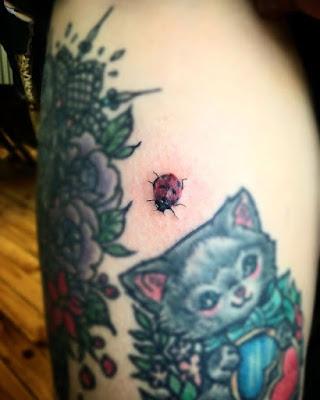 cat and ladybug tattoo