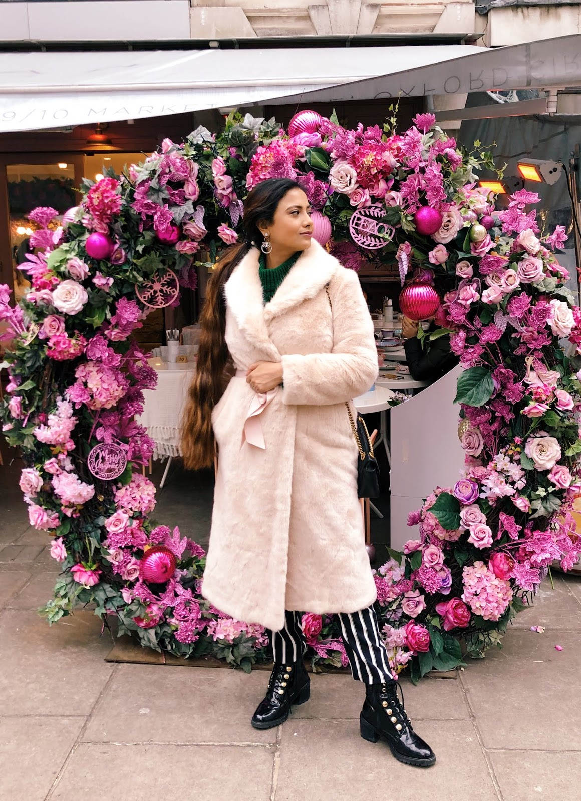 flower wall london, green jumper, élan cafe london, élan cafe market place, striped trousers, mountain boots, h&m trousers, effortless chic, london style, how to brighten winter, london blogger, indian blogger, what to wear in london, london cafe, london insta spot,