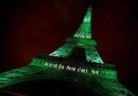 """The Eiffel Tower is illuminated green with the words """"Paris Agreement is Done"""" to celebrate the pact on Nov. 4, 2016. (Credit: Jacky Naegelen/Reuters) Click to Enlarge."""