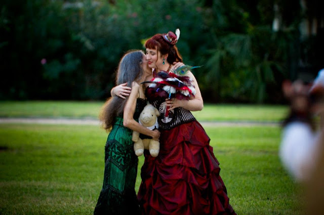 steampunk wedding, steampunk bride and groom, louise black corset, galveston, wedding, kempner park, red wedding dress