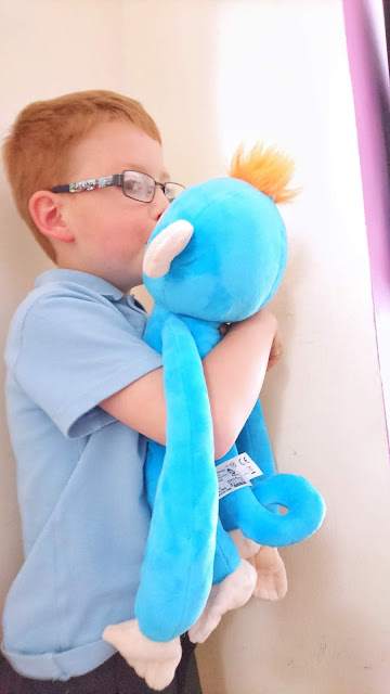 Fingerlings Hugs Review on Us Two Plus You - Dylan giving Boris kisses.