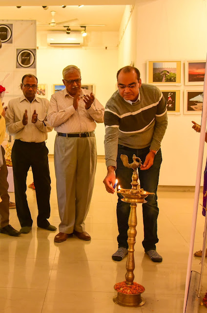Me inaugurating the Photography Exhibition by lighting the lamp