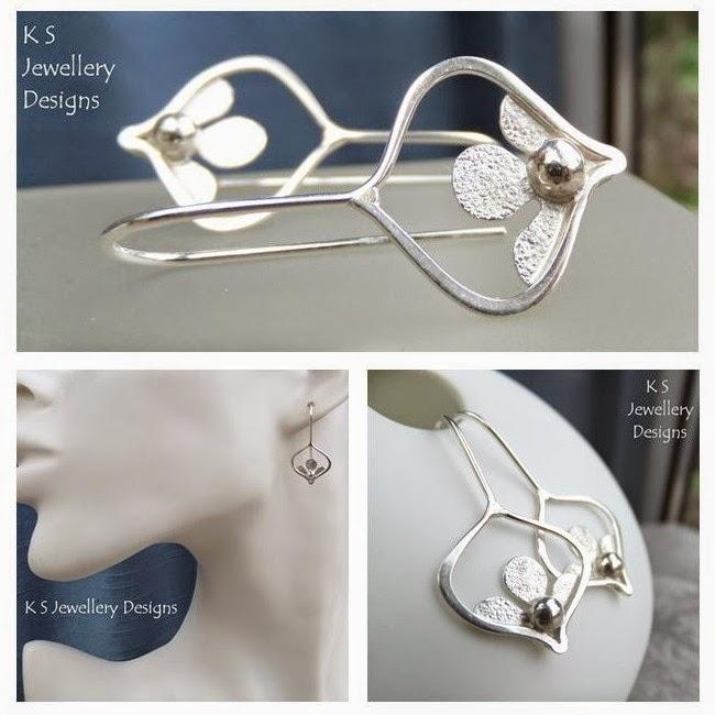 http://ksjewellerydesigns.co.uk/ourshop/prod_3500766-Sterling-Silver-Flower-Drop-Earrings-Peeping-Flowers.html