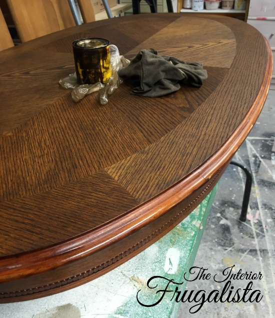 Dark Walnut stained oval pedestal coffee table