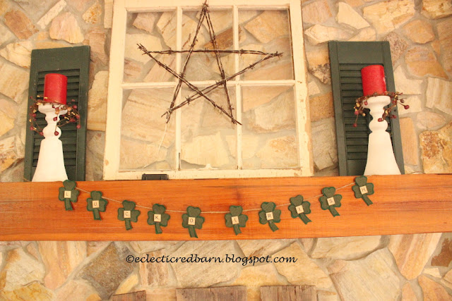 Eclectic Red Barn: Shamrock banner on fireplace mantel