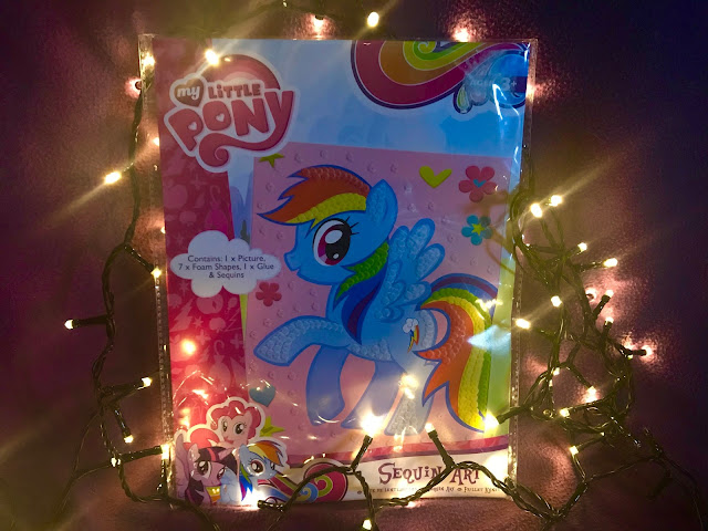 A Sequin Art set of Rainbow Dash from My Little Pony surrounded by fairy lights