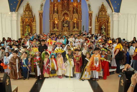 Children of Holy Angels University wearing saints' costumes.