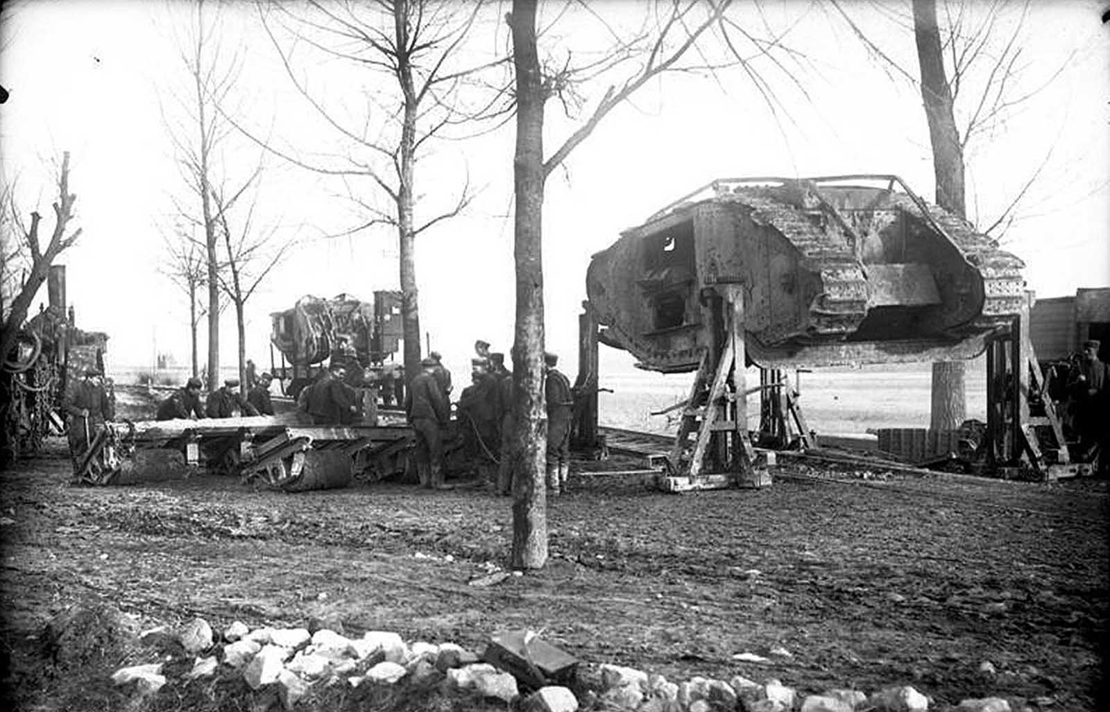 At Cambrai, German soldiers load a captured British Mark I tank onto a railroad, in November of 1917. Tanks were first used in battle during World War I, in September of 1916, when 49 British Mark I tanks were sent in during the Battle of Flers-Courcelette.
