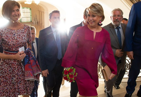 Maria Teresa wore a matching pink jacket and dress by Paule Ka