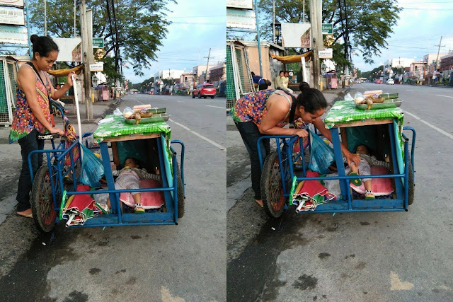 A Devoted Mother Carries Her Infant In Her Cart While Selling Food To The Devoted