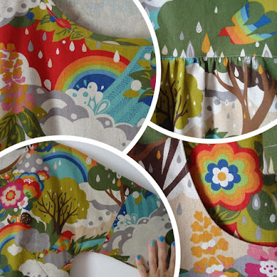 Fen dress details with rainbows, flowers and trees