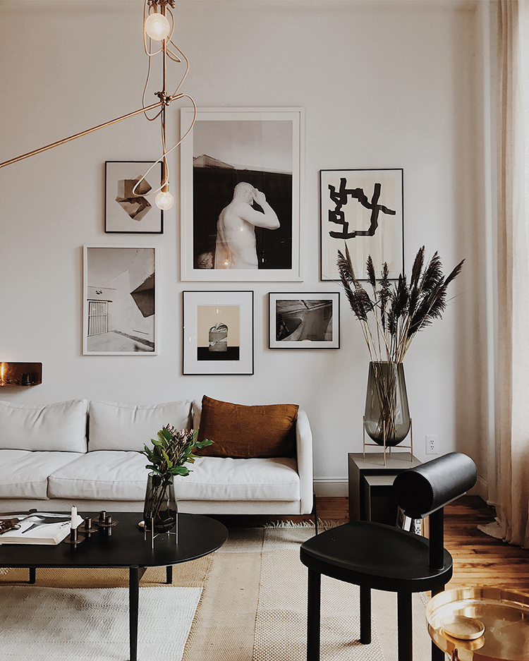 Gallery wall above the sofa in TRNK via Bright Bazaar
