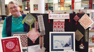 Iryna Varabei at her display of embroidered works and patterns for sale