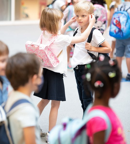 Prince Jacques and Princess Gabriella, twins of Prince Albert and Princess Charlene, started first day of school at Stella School. pink satchel
