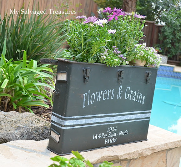 upcycled garden planter made from an ammunition case