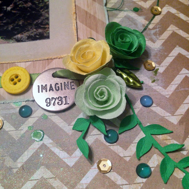 Detail of the Imagine by Alice Scraps Wonderland:  Rolled roses in green and yellow from Michael's and little gems and sequins add depth and sparkle.