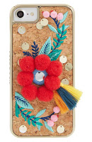 http://shop.nordstrom.com/s/skinnydip-scandi-pom-embellished-iphone-6-7-6-7-plus-case/4618935?origin=keywordsearch-personalizedsort&fashioncolor=RED