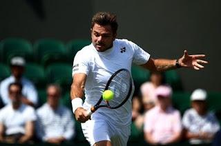 Wawrinka wins first round at Wimbledon