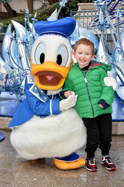 Donald Duck with a little boy