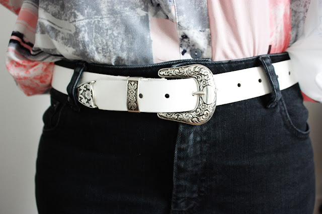 Close up of the Leather Western Tip Waist and Hip belt from asos