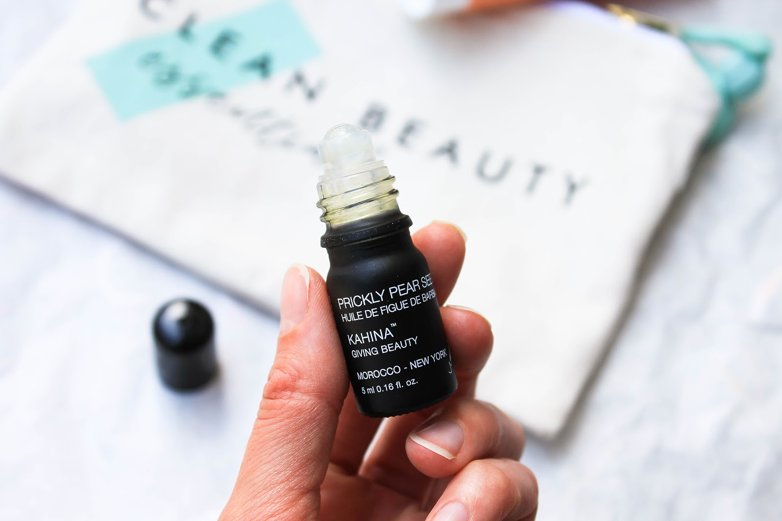May Art of Organics Clean Beauty Box Clean Beauty Essentials. JET SET. Kahina Giving Beauty Prickly Pear Seed Oil Undereye Rollerball.