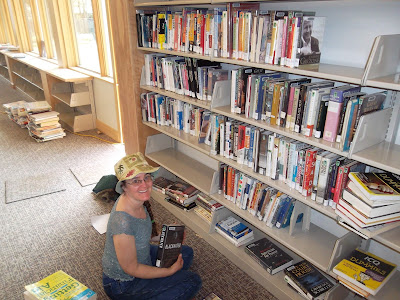 Cynthia Parkhill shelves books at Middletown Public Library