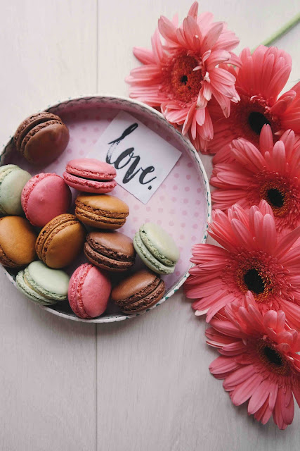 Macarons and Gerbera Daisies | Photo by Brigitte Tohm via Unsplash
