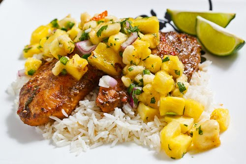 Jerk fish on coconut rice topped with banana and pineapple for Rice recipes to go with fish