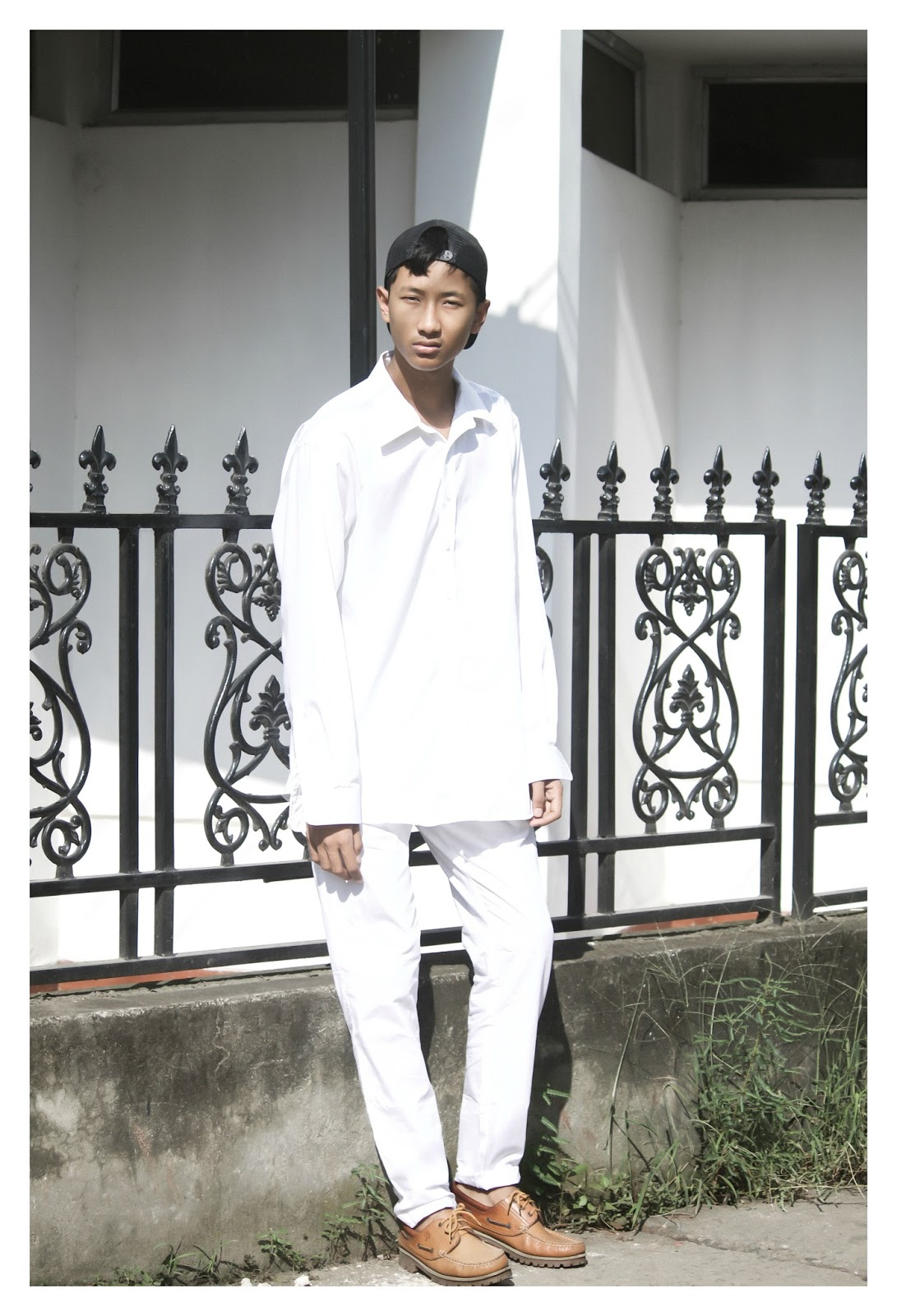 TheQuirkyMinimal by Kangkan Rabha wearing Mr.Button Trousers, Woodland Shoes & Mr.Button laptop-sleeve