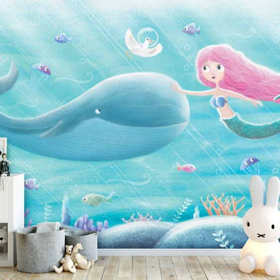 A wall mural featuring a whale and a mermaid