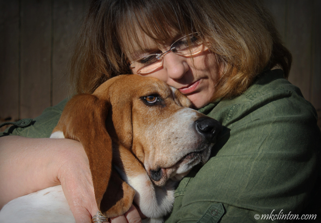 Woman hugging Basset Hound