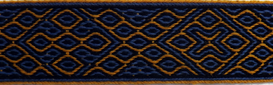 A photograph of a tablet woven band in black blue and yellow made using the pattern below