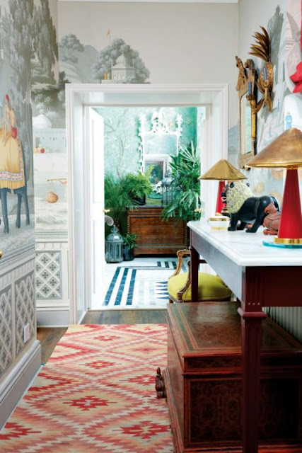antique console and trunk in this beautiful hallway.