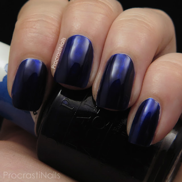 Swatch of OPI Indigo Motif which is a deep blue jelly polish