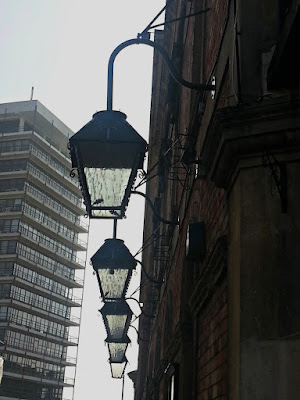 Row of five lanterns hanging outside a building in Bristol