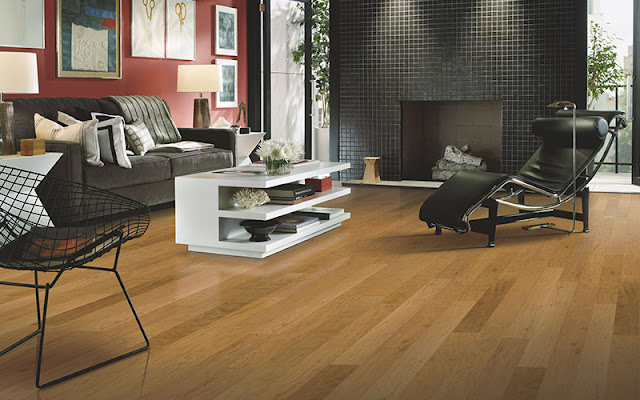 Beautiful hardwood flooring opens up this living area