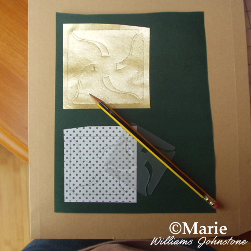 Drawing around your plastic pinwheel template onto the papers
