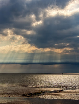 Photo of sun breaking through the clouds over the Solway Firth