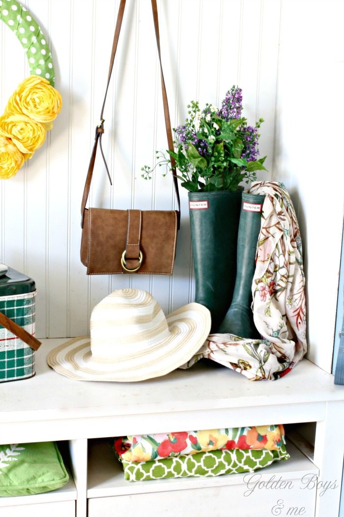 Spring decor with rain boots and bead board in mudroom - www.goldenboysandme.com