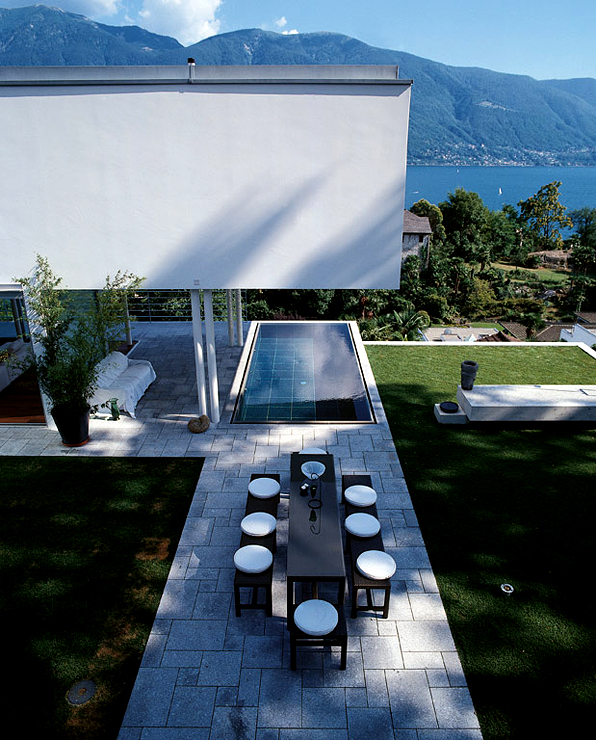 The East Wing Of The Building Extends As An Overhang Above Dark Granite  Tiled Pool With Shimmering Water And A Spectacular View Of The Swiss Alps  And Deep ...