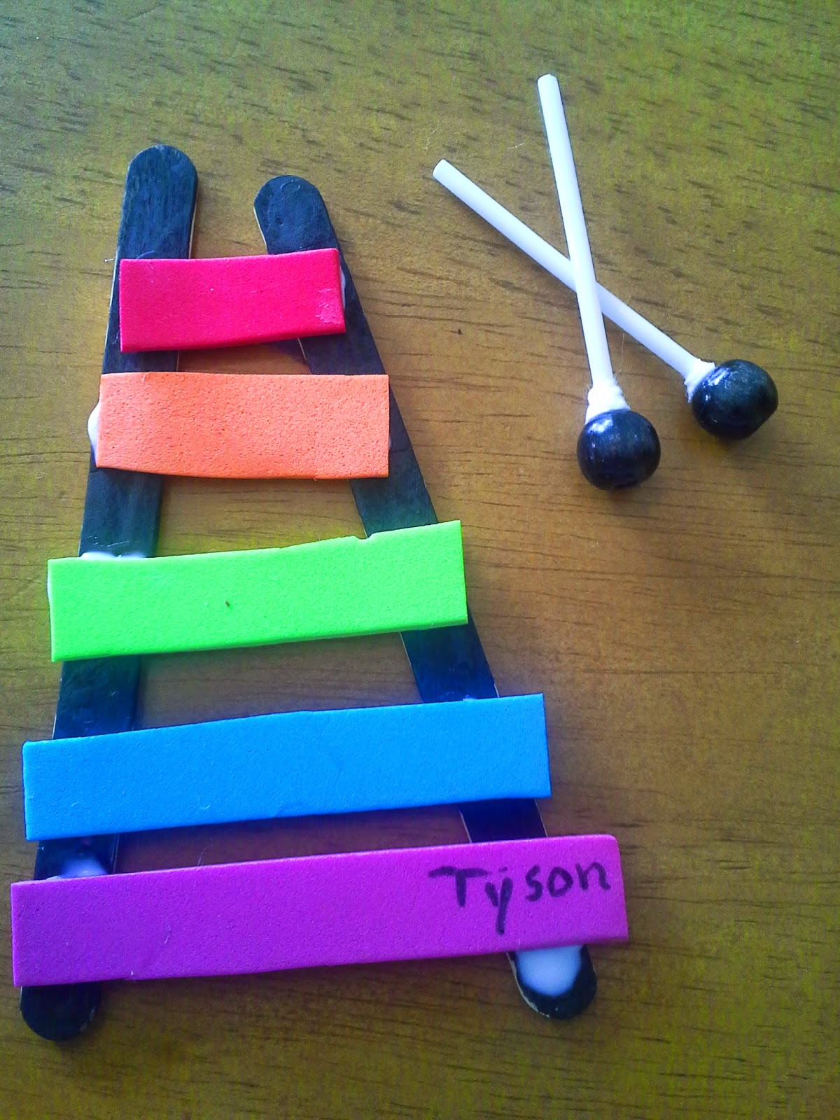 Example of a student's handmade xylophone, using popsicle sticks and foam.