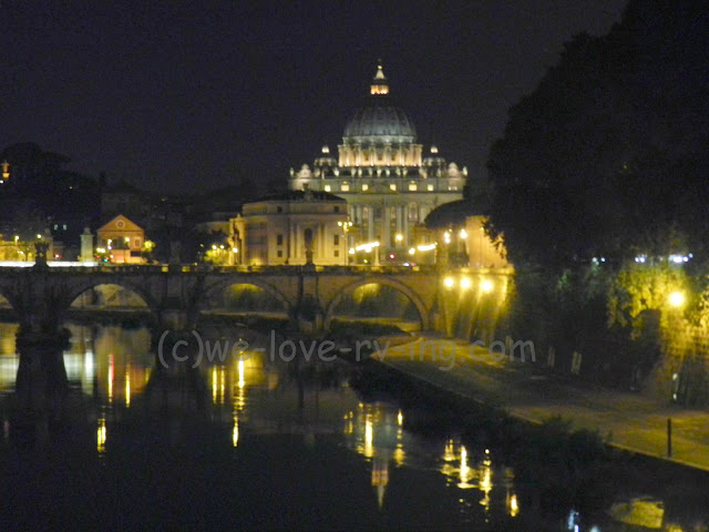 We see St. Peter's Basilica lit up in the distance