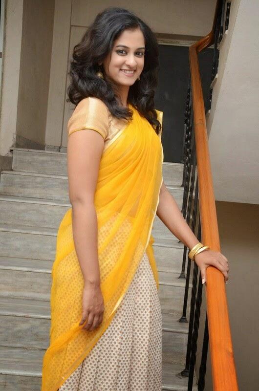 Nanditha Raj Hip Navel Show Photos In Yellow Half Saree