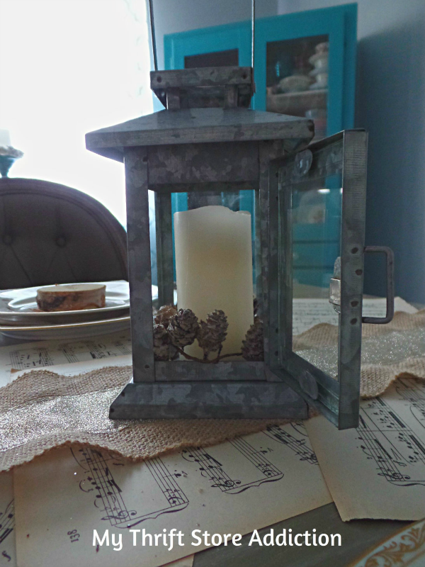 How I Created a Warm Winter Tablescape in 10 Minutes!  mythriftstoreaddiction.blogspot.com  Add pinecones and a candle to a summer clearance lantern for winter!