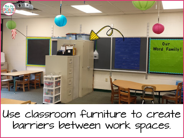 Use classroom furniture to create barriers between work spaces.