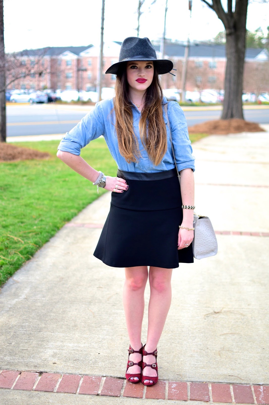 chambray top tucked into black skirt