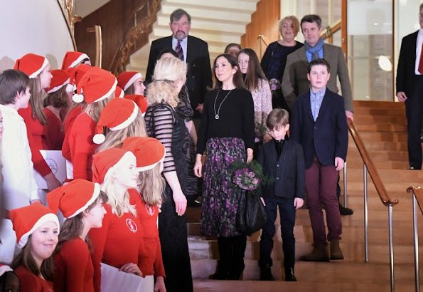 Princess Mary wore HEARTMADE Julie Fagerholt cape, Ralph Lauren white knit sweater, Prada boots and carried Bottega Veneta bag