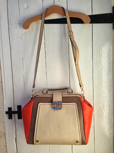a full photo of the cream and orange doctors style handbag from River Island