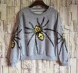 http://ru.dresslink.com/womens-new-fashion-round-neck-cool-spider-pattern-sweatshirts-splicing-outerwear-p-17069.html